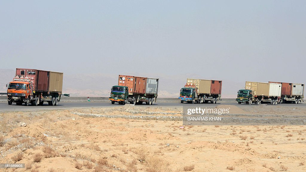 NATO supply trucks carrying NATO equipment enter Quetta on February 12, 2013. The US military has started to withdraw equipment from Afghanistan through Pakistan ahead of next year's deadline for combat troops to leave the war against the Taliban, an official said. AFP PHOTO/Banaras KHAN