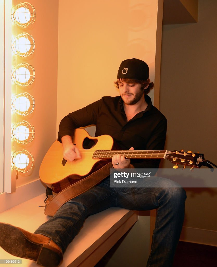 Support Act <a gi-track='captionPersonalityLinkClicked' href=/galleries/search?phrase=Thomas+Rhett&family=editorial&specificpeople=9092574 ng-click='$event.stopPropagation()'>Thomas Rhett</a> backstage during Opening Night of Chris Young's Liquid Neon Tour (SOLD OUT) at the Ryman Auditorium on November 15, 2012 in Nashville, Tennessee.