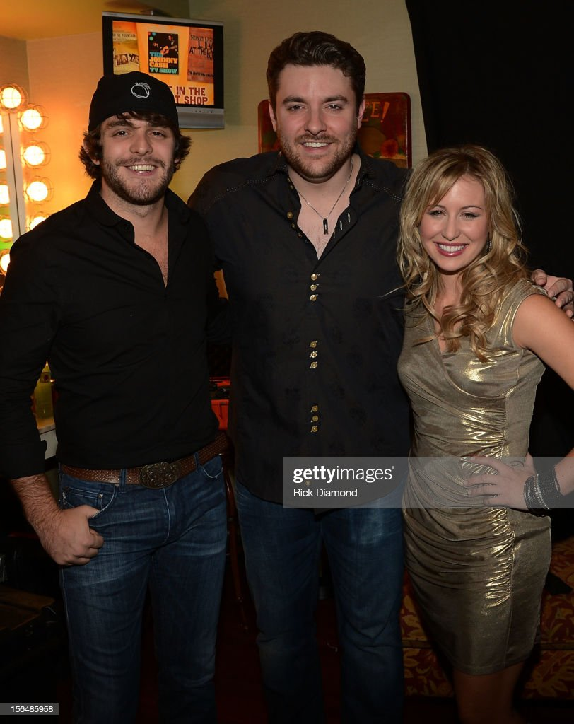 Support Act <a gi-track='captionPersonalityLinkClicked' href=/galleries/search?phrase=Thomas+Rhett&family=editorial&specificpeople=9092574 ng-click='$event.stopPropagation()'>Thomas Rhett</a>, Chris Young and Support Act Joanna Smith backstage during Opening Night of Chris Young's Liquid Neon Tour (SOLD OUT) at the Ryman Auditorium on November 15, 2012 in Nashville, Tennessee.