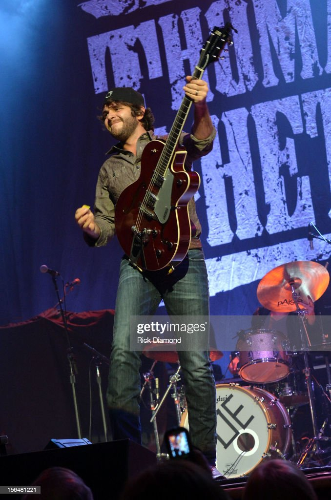 Support Act <a gi-track='captionPersonalityLinkClicked' href=/galleries/search?phrase=Thomas+Rhett&family=editorial&specificpeople=9092574 ng-click='$event.stopPropagation()'>Thomas Rhett</a> performs during Opening Night of Chris Young's Liquid Neon Tour (SOLD OUT) at the Ryman Auditorium on November 15, 2012 in Nashville, Tennessee.