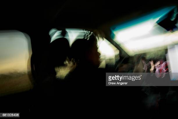 Support scientist Rachel Humphrey drives the tornado scout vehicle as they chase a supercell thunderstorm May 9 2017 in Lamb County Texas Tuesday was...