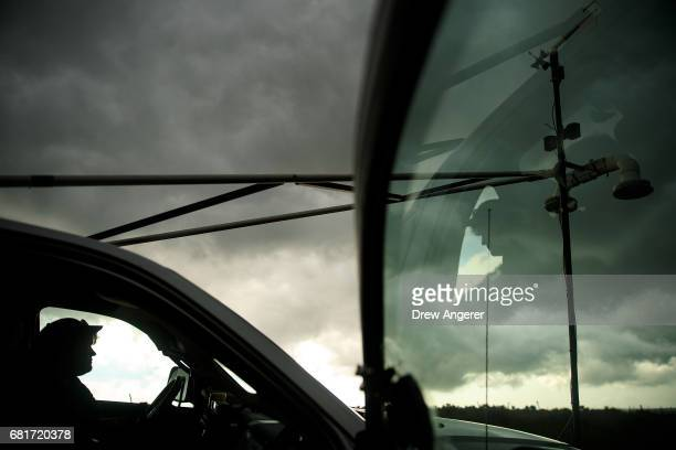 Support scientist Rachel Humphrey sits in the driver seat as she observes a thunderstorm May 10 2017 in Olustee Oklahoma Wednesday was the group's...