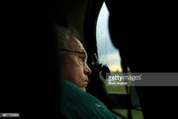 Support scientist Tim Marshall a 40 year veteran of storm chasing looks out the window of a tornado scout vehicle as the group tracks a supercell...