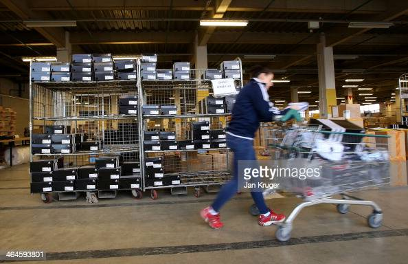 BOA support staff collects and pack athletes uniform during the Team GB Kitting Out ahead of Sochi Winter Olympics on January 23 2014 in Stockport...
