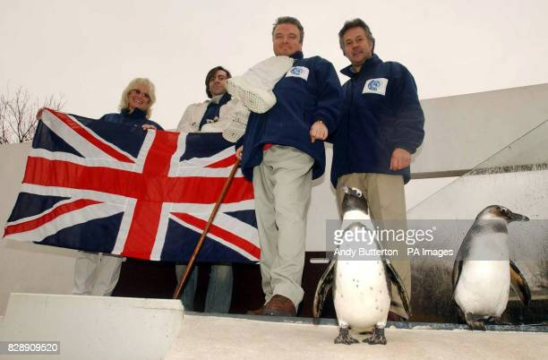 Support team Babs Powell Pedro Munoz and Miles Peckham with Michael McGrath and Amelia the penguin during a photocall at the penguin enclosure in...