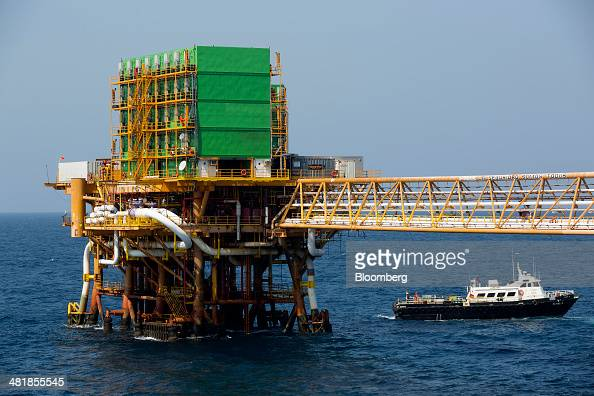 A support vessel sails away from the Petroleos Mexicanos PolA Platform complex located on the continental shelf in the Gulf of Mexico 70 kilometers...