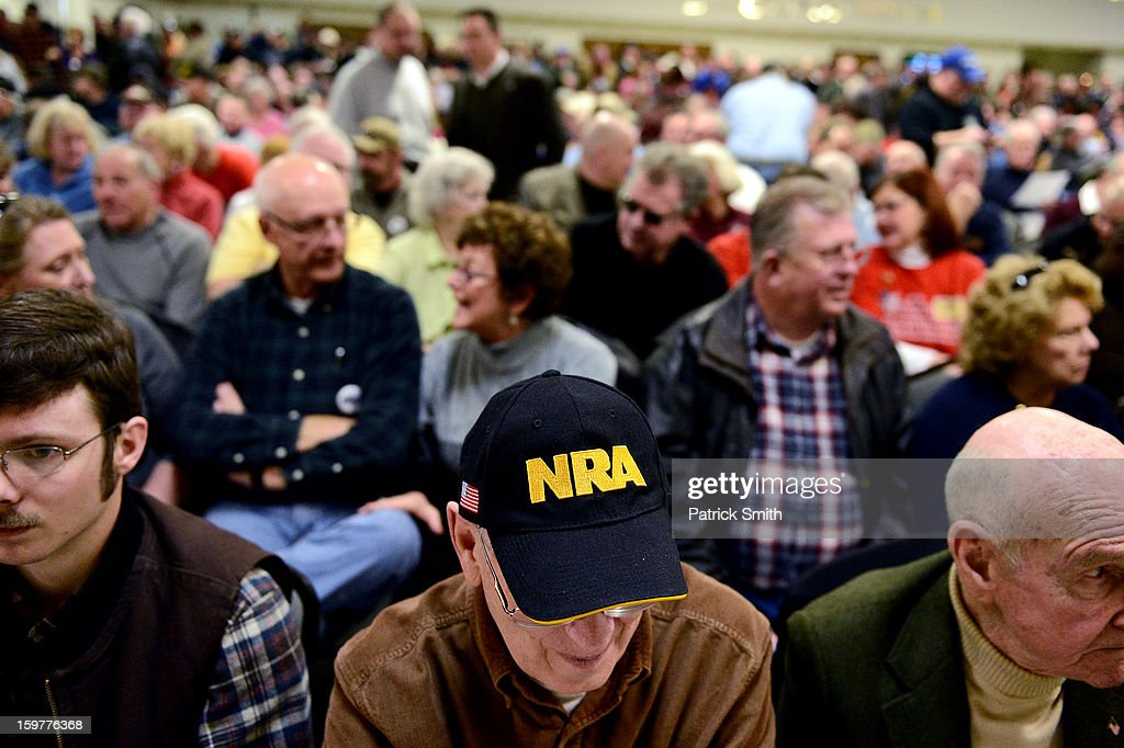 A support wears an NRA hat during the Delaware State Sportsmen's Association Second Amendment rally at the Modern Maturity Center on January 20, 2013 in Dover, Delaware. U.S. President Barack Obama recently unveiled a package of gun control proposals that include universal background checks and bans on assault weapons and high-capacity magazines.