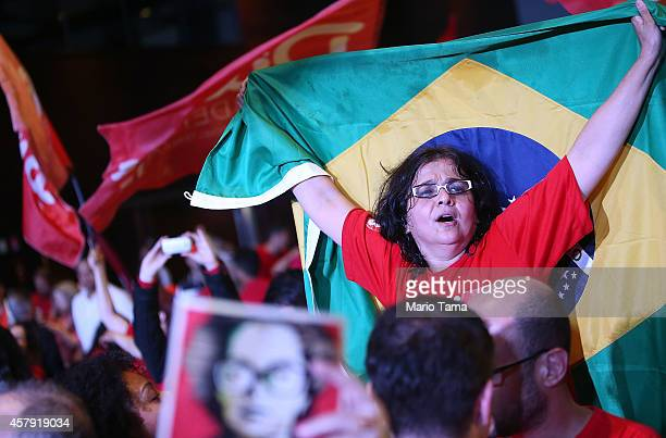 Supported of Brazilian President and Workers' Party candidate Dilma Rousseff celebrate after Rousseff is reelected on October 26 2014 in Brasilia...