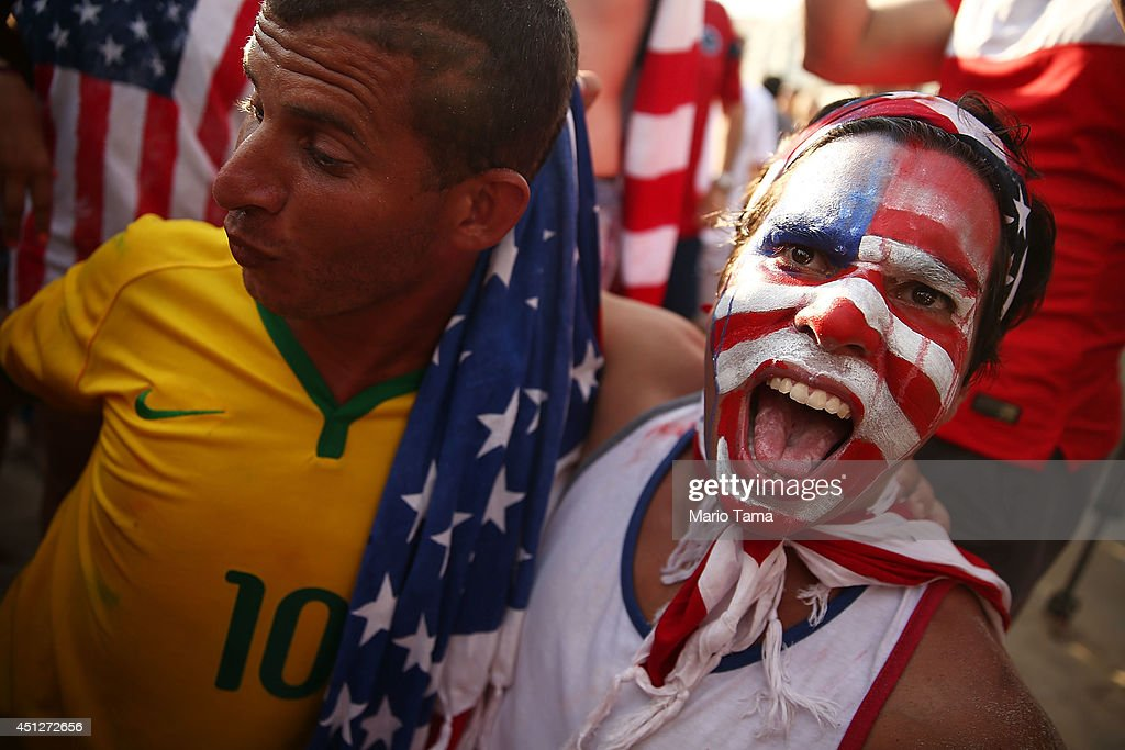 S. supporter and a Brazil supporter celebrate the U.S. advancing to the Round of 16 after their loss to Germany while watching the match at FIFA Fan Fest on June 26, 2014 in Rio de Janeiro, Brazil. The U.S. lost 1-0 but still advance to the knockout stage of the 2014 FIFA World Cup based on goal differential.