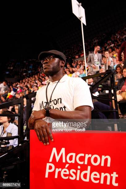 Supporter attend French presidential candidate Emmanuel Macron campaign rally at Bercy Arena on April 17 2017 in Paris France