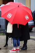 A supporter carrying a red umbrella with the the slogan 'Labour In For Britain' shelters from the rain at a launch event for the 'Labour In Britain'...
