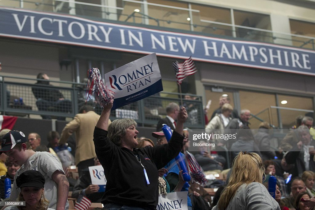 A supporter cheers during a campaign rally for Republican presidential candidate Mitt Romney at the Verizon Wireless Center in Manchester, New Hampshire, U.S., on Monday, Nov. 5, 2012. President Barack Obama beseeched core supporters and wayward backers to go to the polls, while Romney reached for an upset victory powered by anti-incumbent fervor on the final full day of a race that polls suggest has tilted slightly in the president's favor. Photographer: Andrew Harrer/Bloomberg via Getty Images