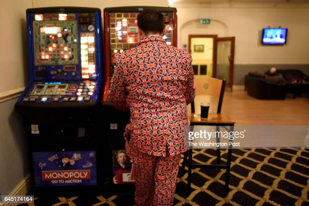 UKIP supporter clad in a Union Jack suit plays a video game in Stoke on Trent United Kingdom on February 23 2016 The populist right wing UKIP party...