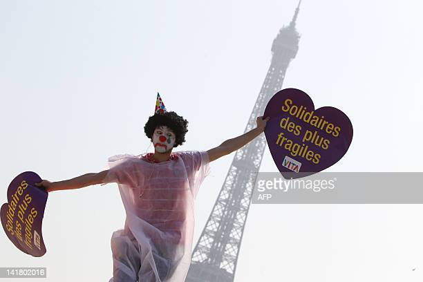 A supporter dressed up like a clown takes part in a flash mob event organized by the 'Alliance VITA' association as part of their tour of France in...