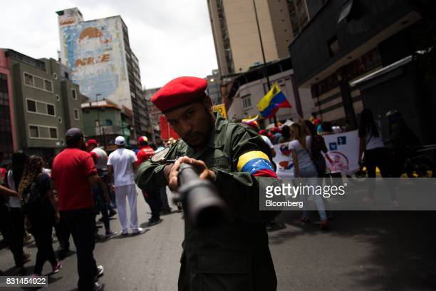 A supporter dresses as a member of the Armed Forces of Venezuela during a progovernment rally against US President Donald Trump in Caracas Venezuela...