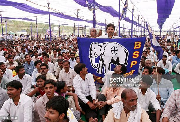 A supporter flaunts a BSP flag at Mayawati's election rally on May 3 2009 at Ramlila Ground India India is the world's largest democracy and voting...