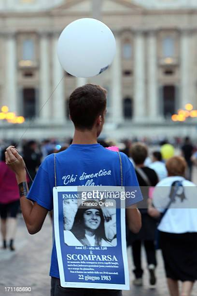 A supporter gathers with others in St Peter's Square to mark the 30th anniversary of the disappearance of Emanuela Orlandi on June 22 2013 in Vatican...