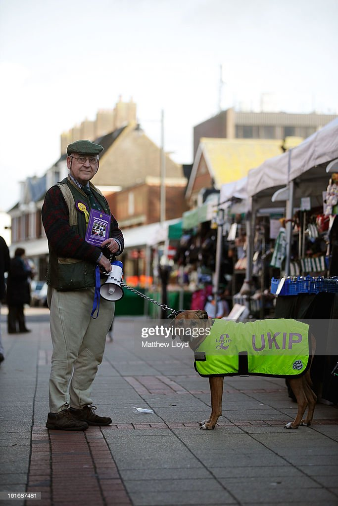 UKIP supporter Graham Harper and his dog Roque poses for a picture whilst canvassing for votes in the town centre on February 14, 2013 in Eastleigh, Hampshire. A by-election has been called in the constituency of Eastleigh after it's former MP, Chris Huhne, resigned after pleading guilty to perverting the course of justice over claims his ex-wife took speeding points for him in 2003.