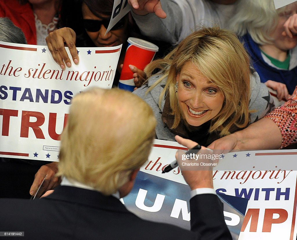 A supporter greets GOP presidential candidate Donald Trump as he signs autographs for supporters following his speech at the Cabarrus Arena on Monday...