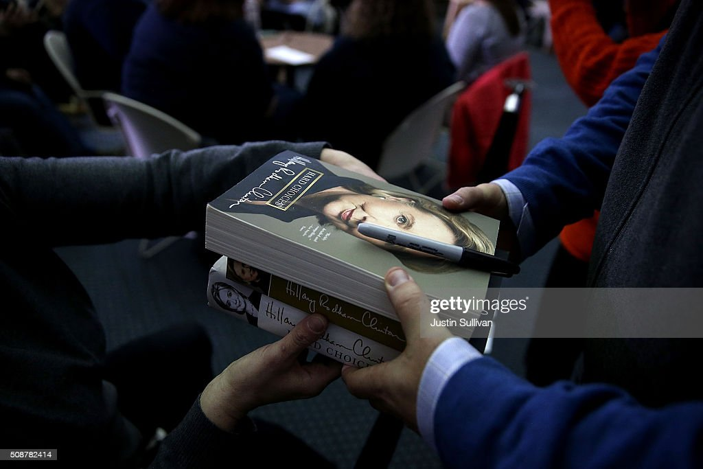 A supporter hands a staff member books to be signed by Democratic Presidential candidate former Secretary of State <a gi-track='captionPersonalityLinkClicked' href=/galleries/search?phrase=Hillary+Clinton&family=editorial&specificpeople=76480 ng-click='$event.stopPropagation()'>Hillary Clinton</a> during a student town hall meeting at New England College on February 6, 2016 in Henniker, New Hampshire. With less than one week to go before the New Hampshire primaries, <a gi-track='captionPersonalityLinkClicked' href=/galleries/search?phrase=Hillary+Clinton&family=editorial&specificpeople=76480 ng-click='$event.stopPropagation()'>Hillary Clinton</a> continues to campaign throughout the state.