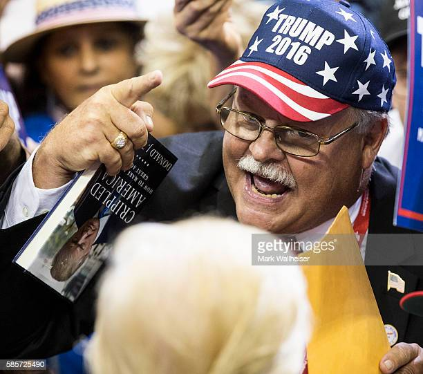 A supporter has a word with Republican presidential nominee Donald Trump after a rally at the Jacksonville Veterans Memorial Arena on August 3 2016...