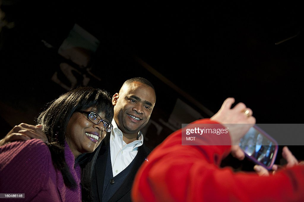 A supporter has her picture taken with newly elected Rep. Marc Veasey during the Lone Star Project Inauguration Celebration, held Sunday, January 20, 2013 at the Hill Country Barbecue in Washington, D.C.