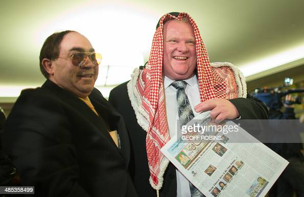 A supporter has his picture taken with Toronto Mayor Rob Ford in a keffiyeh which he presented him at the kickoff of Ford's reelection campaign in...
