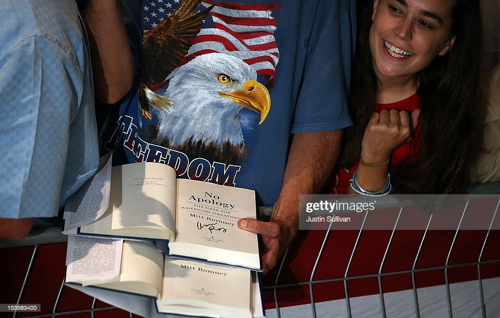 A supporter holding copies of Republican presidential candidate, former Massachusetts Gov. Mitt Romney's book wait to meet him during a campaign rally on October 6, 2012 in Apopka, Florida. Mitt Romney is campaigning in Florida after a visit to the state of Virginia yesterday.