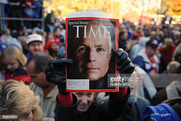 A supporter holds a copy of Time Magazine with US Republican presidential candidate John McCain on the cover at a McCain campaign rally at...