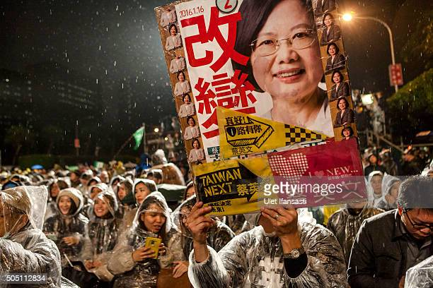 A supporter holds a picture of Democratic Progressive Party presidential candidate Tsai Ingwen during a rally campaign ahead of the Taiwanese...