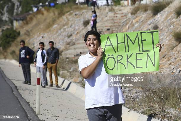 A supporter holds a placard supporting Turkish cyclist Ahmet Örken during 2041 kilometers long Marmaris Selcuk lap within the 53rd Presidential...