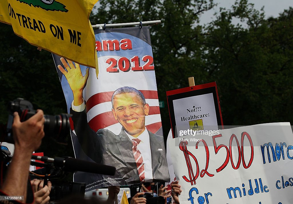 A supporter holds a President Obama campaign sign after the U.S. Supreme Court's decision to uphold President Obama's health care law, on June 28, 2012 in Washington, DC. Today the high court upheld the whole healthcare law of the Obama Administration.