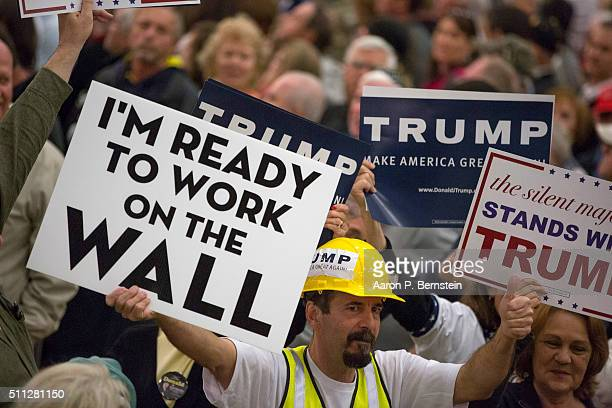 Supporter holds a sign as Republican presidential candidate Donald Trump speaks at a rally February 19 2016 in Myrtle Beach South Carolina Trump is...