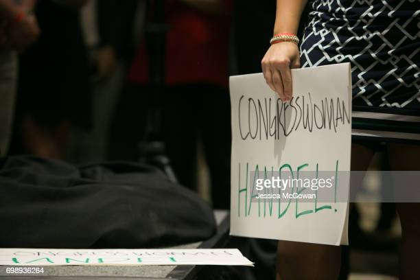 A supporter holds a sign for 'Congresswoman Handel' during a victory speech given by Georgia's 6th Congressional district Republican candidate Karen...