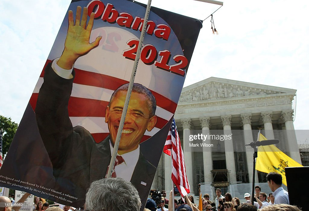 A supporter holds a sign of President Barack Obama in front of the U.S. Supreme Court, on June 28, 2012 in Washington, DC. Today the high court let stand President Obama's health care overhaul, in a victory for the president and Congressional Democrats.