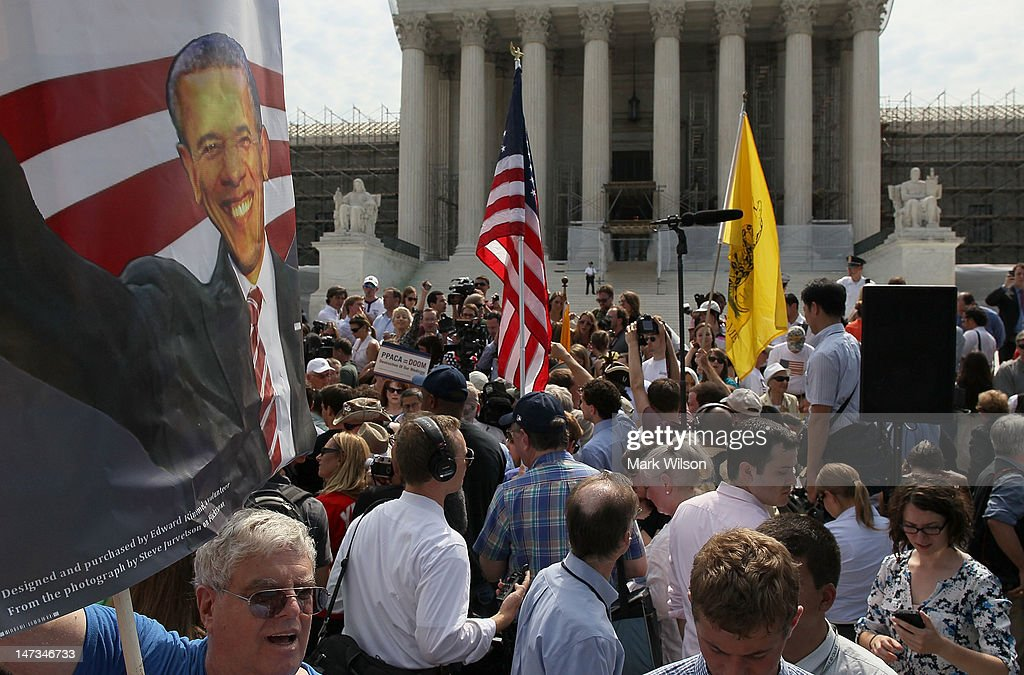 A supporter holds a sign of President Barack Obama in front of the U.S. Supreme Court, on June 28, 2012 in Washington, DC. Today the high court upheld President Obama's health care overhaul, in a victory for the president and Congressional Democrats.