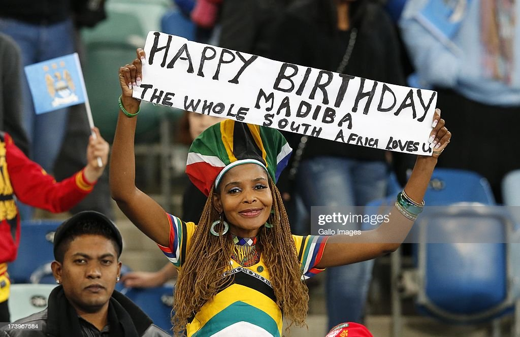 A supporter holds a sign wishing a Happy Birthday to Nelson Mandela during the Nelson Mandela Football Invitational match between AmaZulu and Manchester City at Moses Mabhida Stadium on July 18, 2013 in Durban, South Africa.
