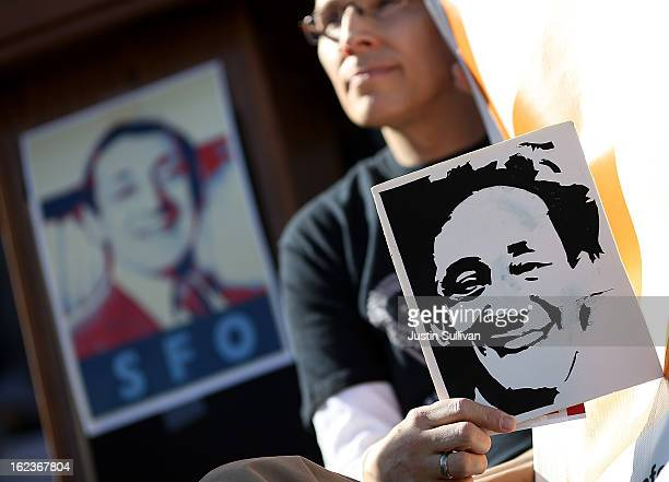 A supporter holds a sign with the image of slain San Francisco supervisor Harvey Milk during a rally at San Francisco City Hall on February 22 2013...
