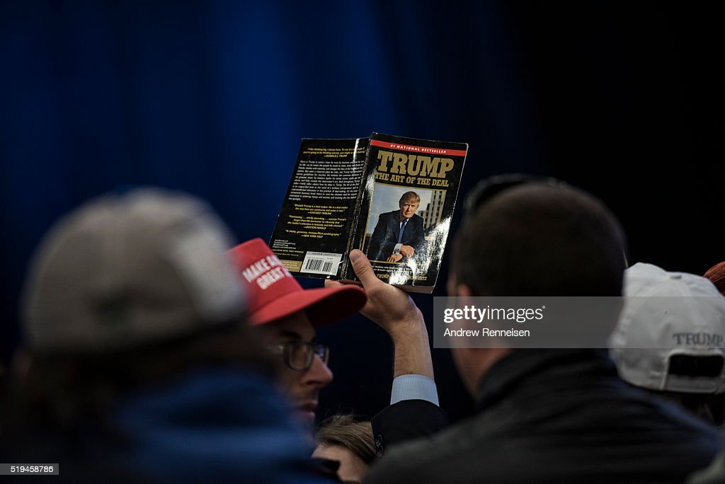 A supporter holds a up a book by Republican Presidential Candidate Donald Trump prior to a campaign rally on April 6, 2016 in Bethpage, New York. The rally comes ahead of the April 15 New York primary.