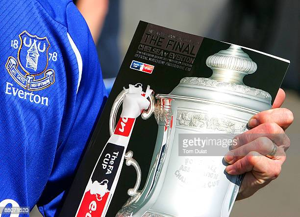 A supporter holds the FA Cup sponsored by EON Final matchday program prior to the FA Cup sponsored by EON Final match between Chelsea and Everton at...