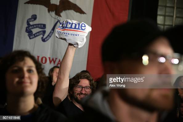 A supporter holds up a 'Bernie For President' Tshirt as Democratic presidential candidate Sen Bernie Sanders speaks to voters during a campaign rally...