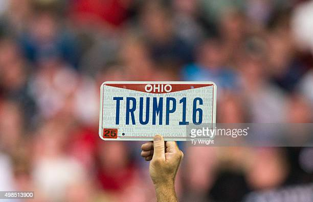 A supporter holds up a personalized license plate labeled 'Trump16' during a campaign rally for Republican presidential candidate Donald Trump at the...