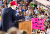 A supporter holds up a sign as Republican presidential candidate Donald Trump speaks during a rally at LaddPeebles Stadium on August 21 2015 in...