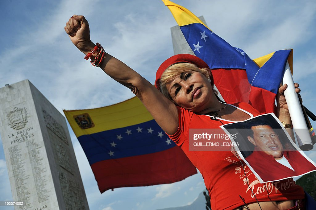 A supporter lines up to pay her last respects to late Venezuelan President Hugo Chavez, outside the Military Academy in Caracas on March 8, 2013. Venezuela gave Hugo Chavez a lavish farewell on Friday at a state funeral that brought some of the world's most notorious strongmen to tears, with music, prayers and a fiery speech by his successor. AFP PHOTO/Guillermo Legaria