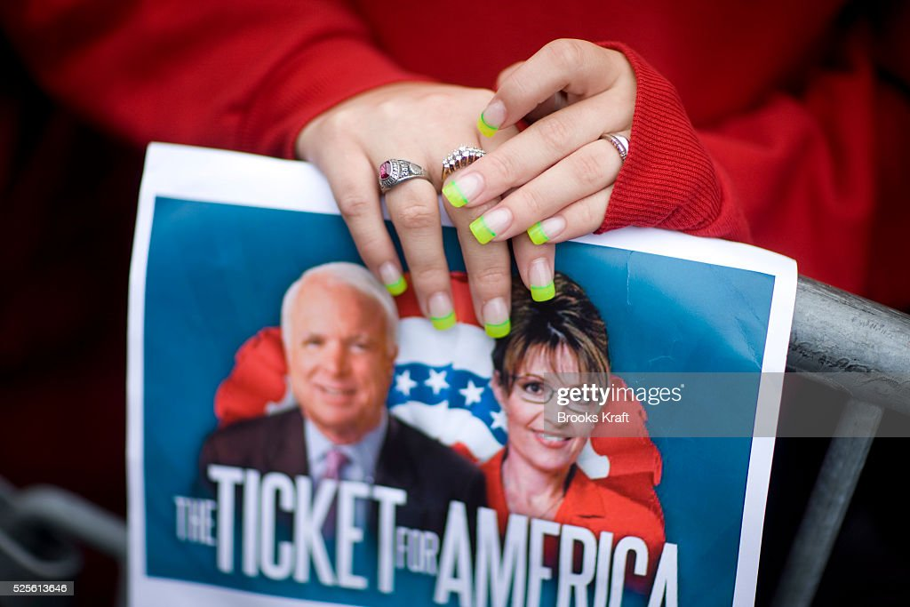 A supporter listens to republican US vicepresidential nominee and Alaska Governor Sarah Palin attend a rally in Lebanon Ohio