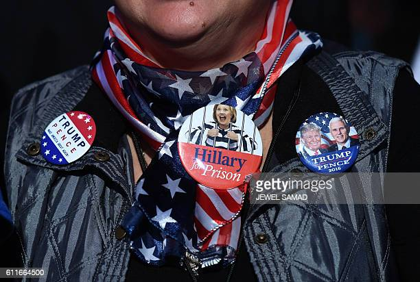 TOPSHOT A supporter listens to US Republican presidential nominee Donald Trump during a campaign rally at the Suburban Collection Showplace in Novi...