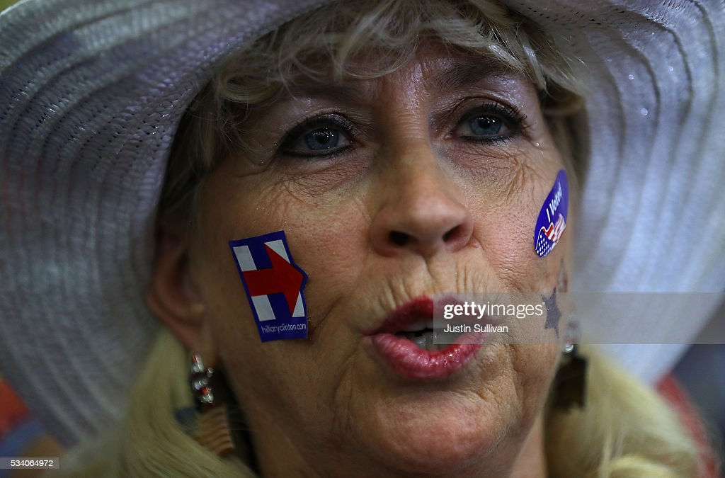 A supporter looks on as democratic presidential candidate former Secretary of State Hillary Clinton speaks during a campaign event on May 24, 2016 in Riverside, California. Hillary Clinton is campaigning in California ahaed of the State's presidential primary on June 7th.