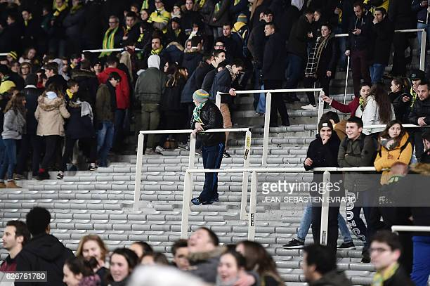 A supporter looks on as Nantes' supporters leave during the French L1 football match between Nantes and Lyon on November 30 2016 at the Beaujoire...