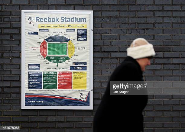 A supporter makes her way to the stadium ahead of the Budweiser FA Cup fourth round match between Bolton Wanderers and Cardiff City at the Reebok...