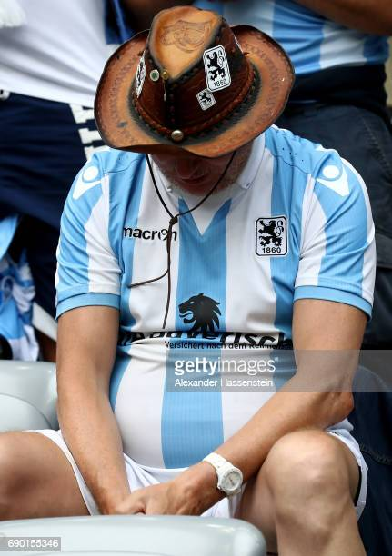 A supporter of 1860 Muenchen looks dejected during the Second Bundesliga Playoff second leg match betweenTSV 1860 Muenchen and Jahn Regensburg at...